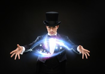 magic, performance, circus and show concept - magician in top hat showing trick