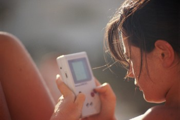 Woman playing with handheld video game