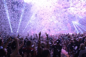 Confetti and smoke cannons with light show at rock concert