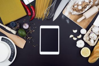 Kitchen cooking tablet pc mockup on black background and kitchen equipment