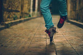 Feet  of hip-hop performer in sneakers